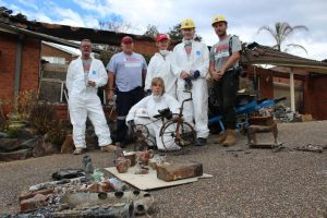 Tathra resident digs up memories from burned home with Team Rubicon