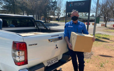 Disaster Relief Teams put down chainsaws and pick up food boxes for ACT communities in lockdown